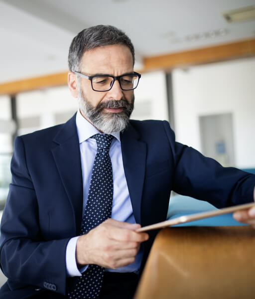 Man looking at tablet in an office setting