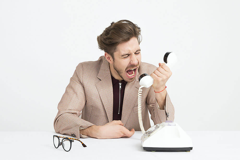 Frustrated 401(k) plan sponsor yelling into the telephone